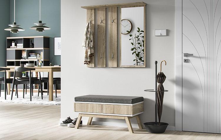 szafka z siedziskiem i wieszak na ścianie w przedpokoju