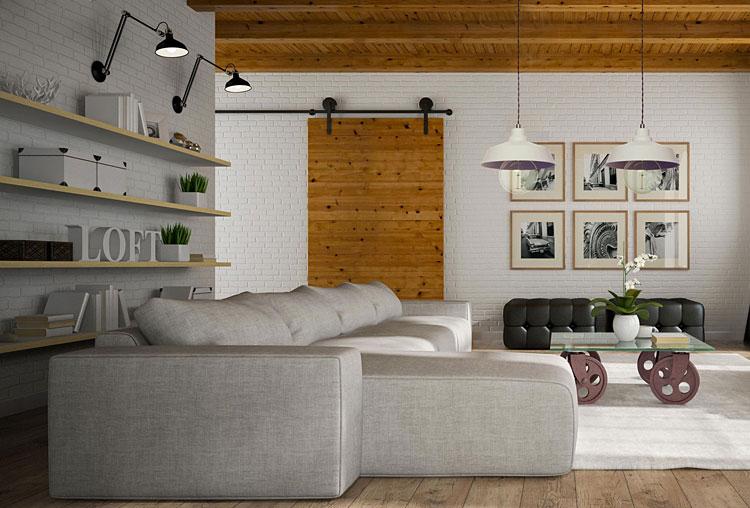 nowoczesny salon ze ścianami z imitacją cegły oraz obrazami